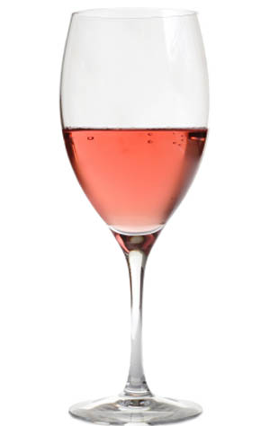 rose wine in crystal glass, isolated on white